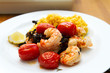 Prawns with risotto rice and tomatoes