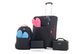 travel suitcases, backpack with clothing, laptop isolated on whi