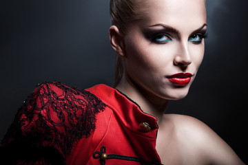 erotic blonde sexy woman in red jacket with red lips