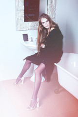 Fashion attractive woman sits on bath
