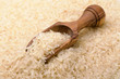 Wooden scoop on long grain rice