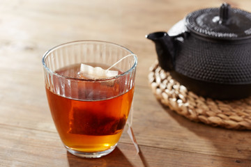 Brown tea on glass cup