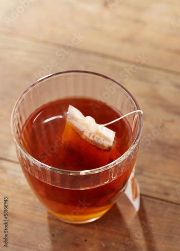 Brown tea on glass cup
