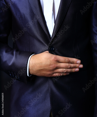 Close up  of stylish man in elegant black suit