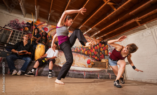 Female Capoeira Performers Sparring