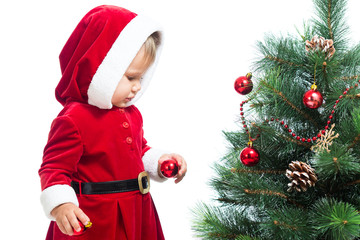 baby girl decorating Christmas tree