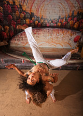 Capoeira Performers Doing Throws