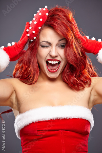 Christmas Santa hat redhead woman portrait . Smiling happy girl