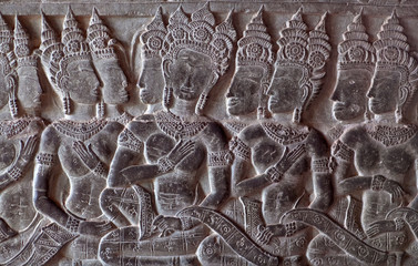Ancient bas-relief at the facade of Angkor Wat