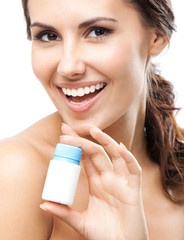 Smiling woman showing medical drug, isolated