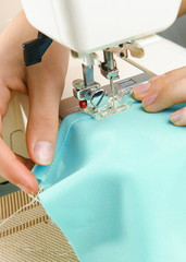 Image of seamstress working   on sewing machine