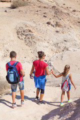 active family walk in the desert