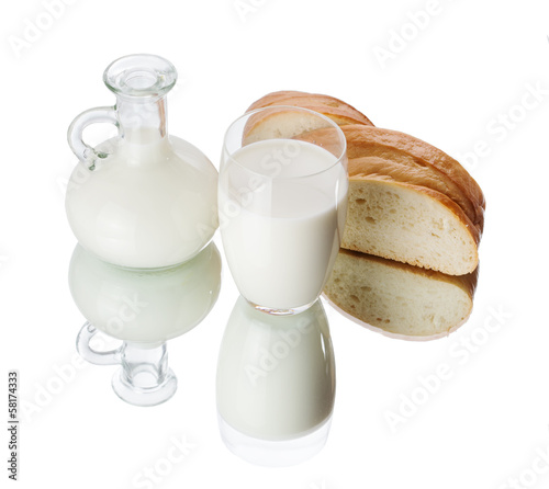 Glass and jug with milk on white background