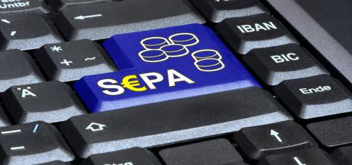 Icon in blau mit S€PA Überweisung