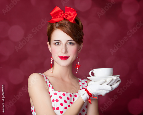Beautiful redhead women with cup of tea.
