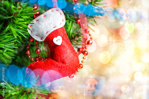 Christmas red sock on fir tree