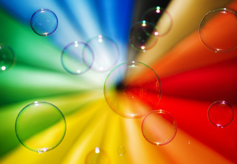 Soap bubbles and multi-coloured background