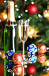 Bottle of champagne with glass and Christmas balls