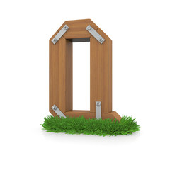 Wooden letter Q in the grass