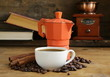 Coffee maker, beans and cup of espresso