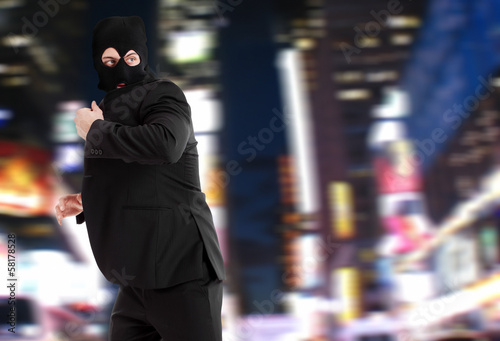 Businessman thief escaping through the city