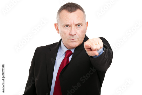 Mature businessman pointing his finger at you