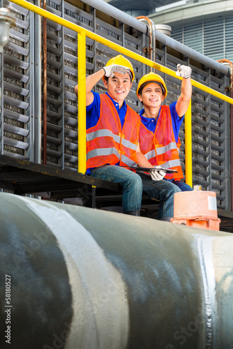Asian technicians or workers on construction site