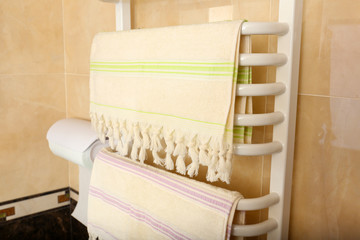 Color towels on  radiator in bathroom