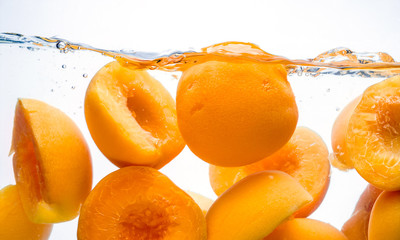 Peach. Preserved fruit splash in water
