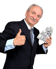 Elderly man holding dollars