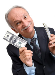 Senior man holding dollars