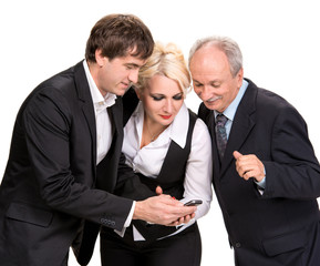 Group of business people looking at a cell phone