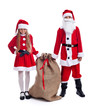 Santa and helper with a large bag of presents