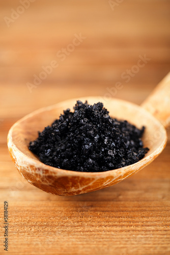 Hawaiian Black lava sea salt in rustic wooden spoon