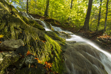 Beautiful waterfalls on a sunny autumn day in the mountains