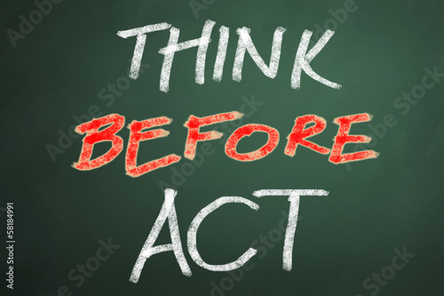 Think before act words on chalkboard backgruond