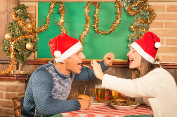 Young Couple flirting with american food at Christmas Dinner
