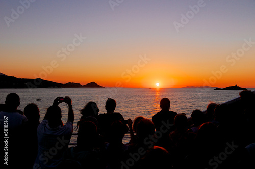 Group of people admiring the sunset, Elba Island, Italy
