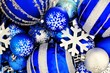 Blue Christmas bauble background with snowflakes