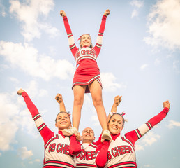 Cheerleaders - Team with male Coach