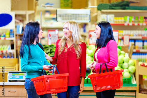 beautiful girls shopping in grocery supermarket