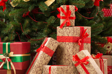 Stack of gift boxes under Christmas tree