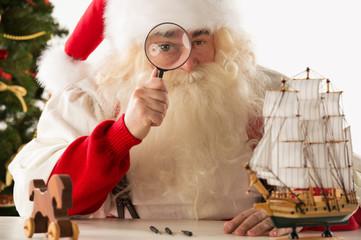Santa Claus making toys. Looking at camera through the zoom