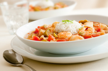closeup of a seafood gumbo with shrimp, scallops and crab meat