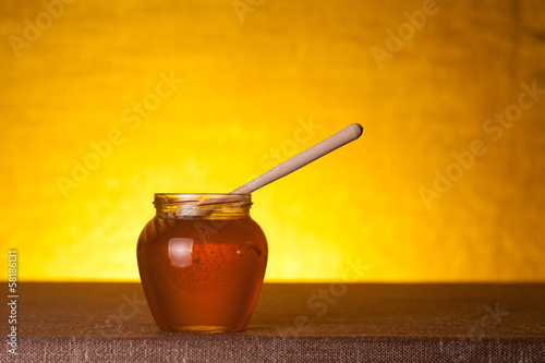 Honey jar on canvas table