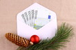 Five hundred euro money in envelope with Christmas deco