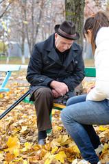 Senior man planning his next chess move