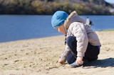 Cute little boy playing on a sandy beach