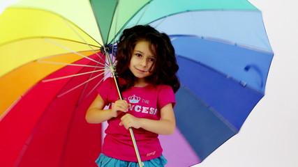 Young girl having fun with umbrella