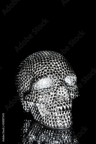 Metal skull with shiny reflective dots